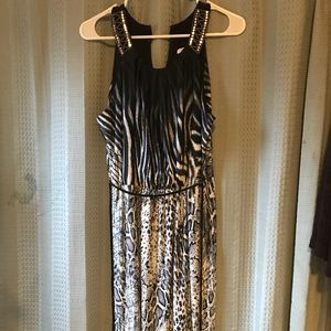 Long black patterned dress.